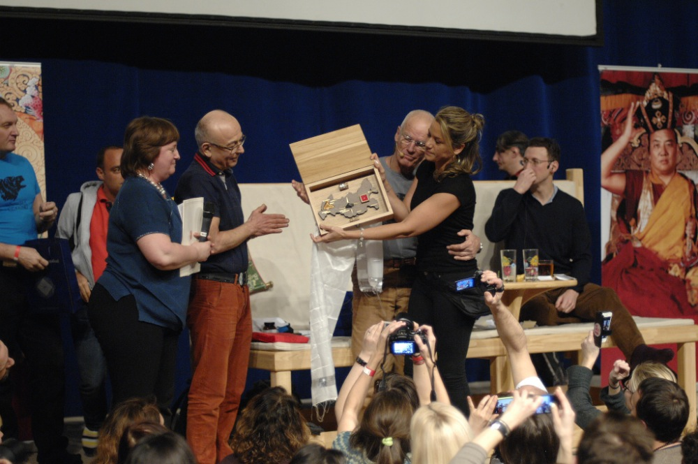 Russian students of Lama Ole give him and his wife Alexandra a symbolic present