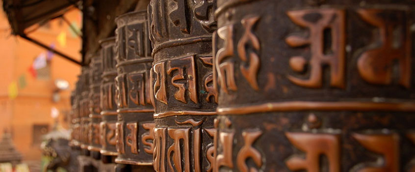 Tibetans turn prayer wheels to send wishes out into the world